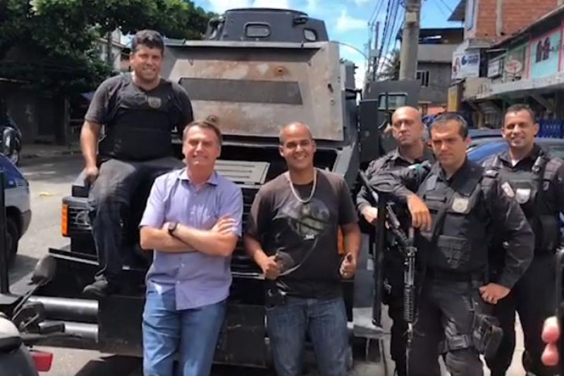 President-elect Jair Bolsonaro (center to left) poses with military police in the Rio de Janeiro neighborhood of Cidade de Deus